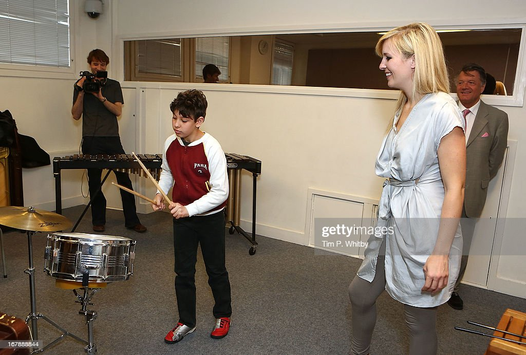 Client 'Erenik' and musician <a gi-track='captionPersonalityLinkClicked' href=/galleries/search?phrase=Alison+Balsom&family=editorial&specificpeople=651462 ng-click='$event.stopPropagation()'>Alison Balsom</a> during a visit to the Nordoff Robbins Music Therapy Centre on May 2, 2013 in London, England.