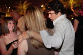 A client of Manhattan dating coach Chris Luna chats with women in a nightclub after a confidencebuilding class August 1 2009 in New York City Luna...