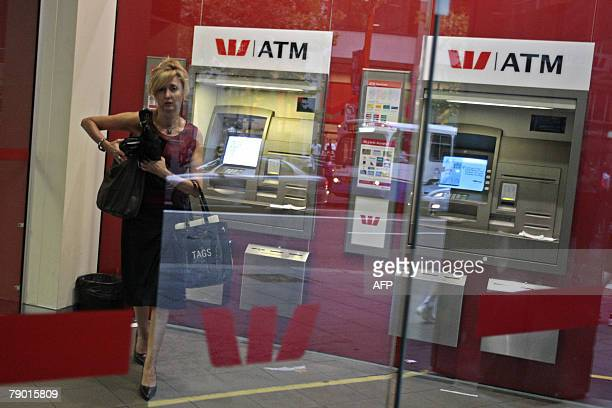 A client walks out of the branch after using the ATM machine at the Australian Westpac Bank 16 January 2008 The WestpacMelbourne Institute index...