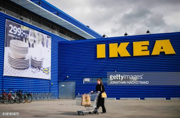 A client walks outside Europe's biggest Ikea store is pictured in Kungens Kurva southwest of Stockholm on March 30 2016 Ikea founder Ingvar Kamprad...