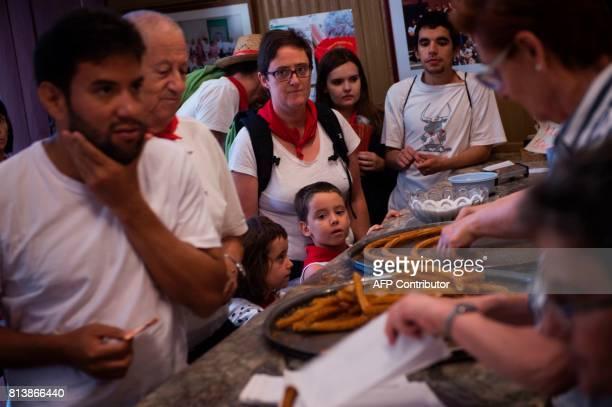 Clients queue to buy 'churros' at the traditional churreria 'La Manueta' on July 13 in Pamplona northern Spain 'La Manueta' a 138 yearold churreria...