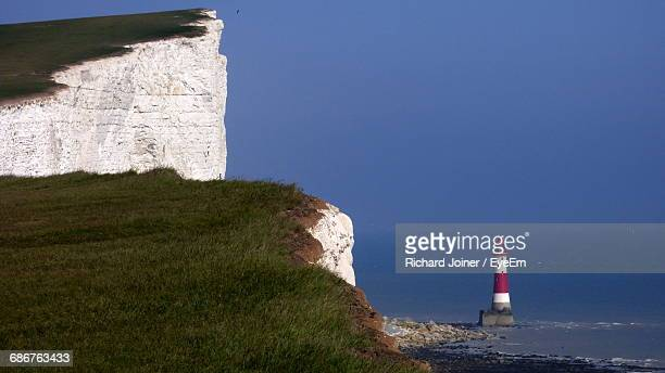 Cliff Against Beachy Head Lighthouse In Sea