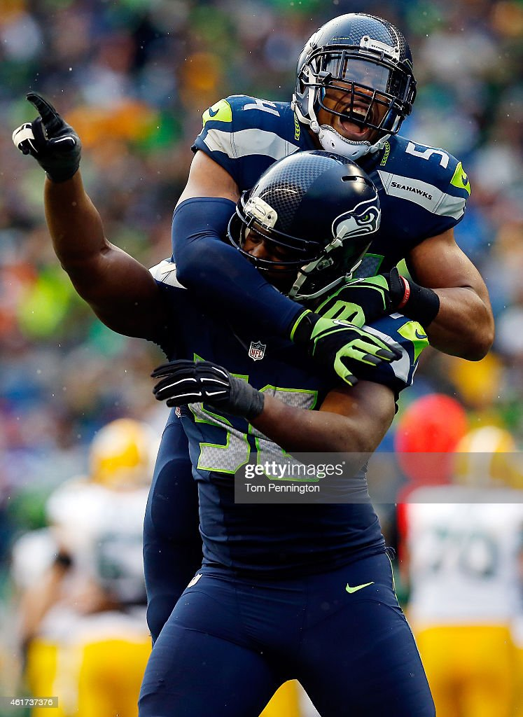 Cliff Avril #56 and Bobby Wagner #54 of the Seattle Seahawks react after making a sack during the third quarter of the 2015 NFC Championship game against the Green Bay Packers at CenturyLink Field on January 18, 2015 in Seattle, Washington.
