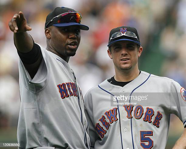 Cliff Floyd and David Wright watch fans after a rain delay today at Wrigley Field in Chicago Illinois on July 14 2006 The New York Mets over the...