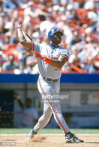 Cliff Floyd of the Montreal Expos bats against the New York Mets during a Major League Baseball game circa 1996 at Shea Stadium in the Queens borough...
