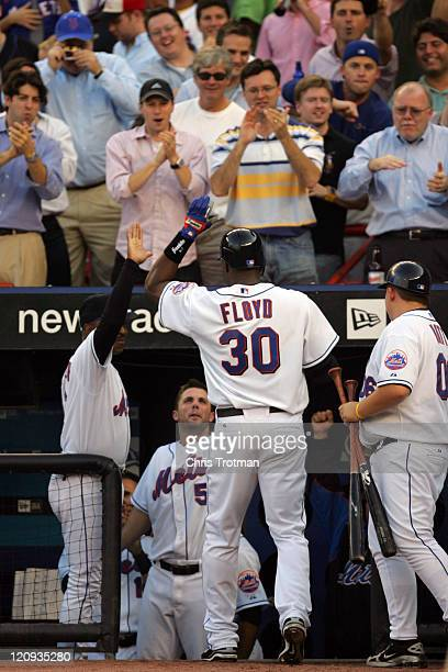 Cliff Floyd of the New York Mets celebrates his home run in the 4th inning against the Los Angeles Dodgers during game one of the 2006 National...