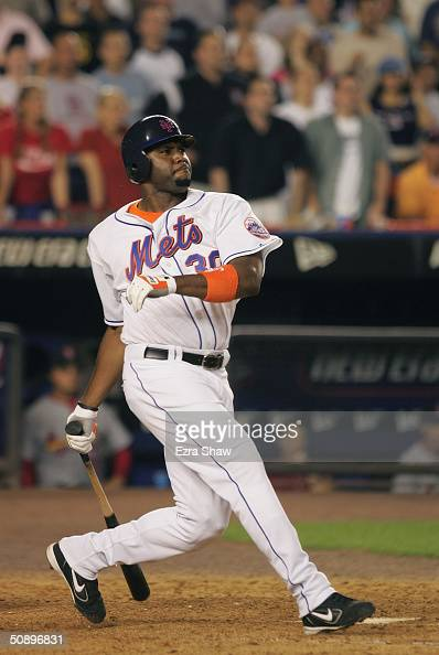 Cliff Floyd of the New York Mets hits the gamewinning single in the bottom of the ninth inning which scored Karim Garcia to defeat the St Louis...