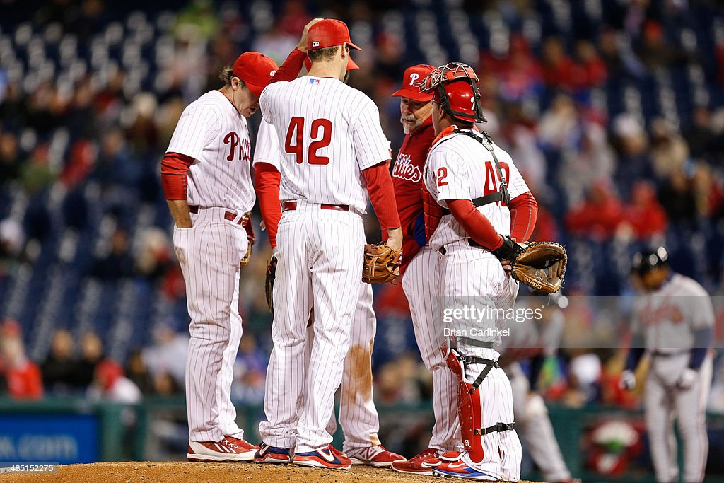 <a gi-track='captionPersonalityLinkClicked' href=/galleries/search?phrase=Cliff+Lee&family=editorial&specificpeople=218092 ng-click='$event.stopPropagation()'>Cliff Lee</a> of the Philadelphia Phillies and the infielders meet on the mound in the ninth inning of the game against the Atlanta Braves at Citizens Bank Park on April 16, 2014 in Philadelphia, Pennsylvania. All uniformed team members are wearing jersey number 42 in honor of Jackie Robinson Day. The Braves won 1-0.