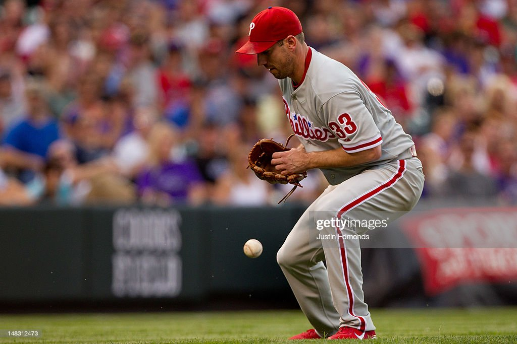 <a gi-track='captionPersonalityLinkClicked' href=/galleries/search?phrase=Cliff+Lee&family=editorial&specificpeople=218092 ng-click='$event.stopPropagation()'>Cliff Lee</a> #33 of the Philadelphia Phillies bobbles a ball hit by Ramon Hernandez of the Colorado Rockies in the third inning at Coors Field on July 13, 2012 in Denver, Colorado. Lee recovered on the play to get the out at first base to end the inning.