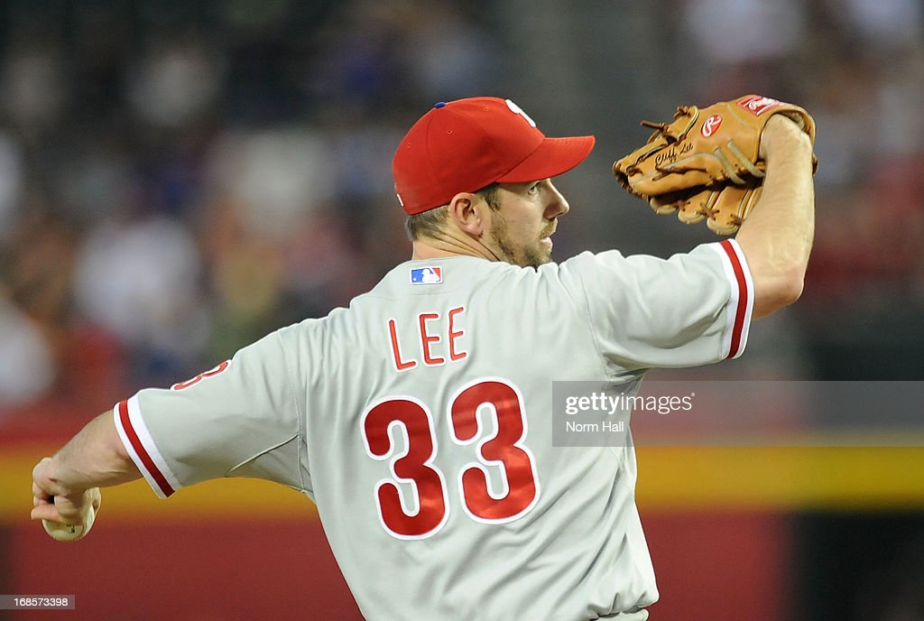<a gi-track='captionPersonalityLinkClicked' href=/galleries/search?phrase=Cliff+Lee&family=editorial&specificpeople=218092 ng-click='$event.stopPropagation()'>Cliff Lee</a> #33 of the Philadelphia Phillies delivers a pitch in the first inning against the Arizona Diamondbacks at Chase Field on May 11, 2013 in Phoenix, Arizona.