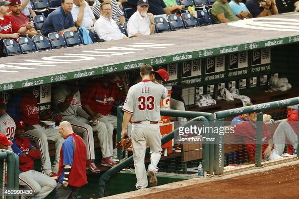 Cliff Lee of the Philadelphia Phillies leaves the field with an apparent injury during the third inning against the Washington Nationals at Nationals...