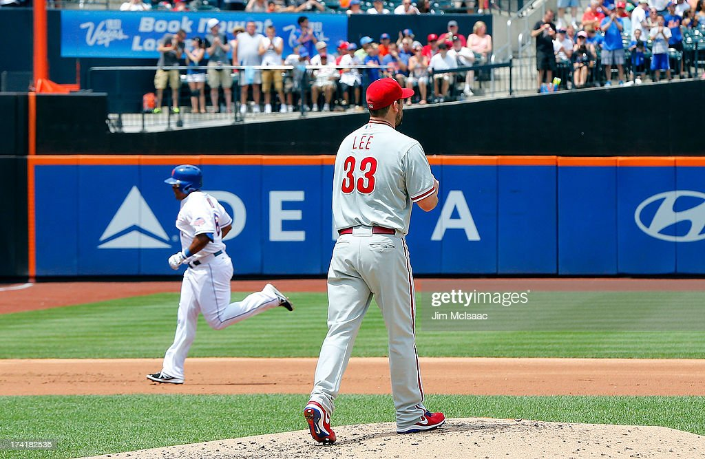 <a gi-track='captionPersonalityLinkClicked' href=/galleries/search?phrase=Cliff+Lee&family=editorial&specificpeople=218092 ng-click='$event.stopPropagation()'>Cliff Lee</a> #33 of the Philadelphia Phillies looks on after surrendering a first inning home run against <a gi-track='captionPersonalityLinkClicked' href=/galleries/search?phrase=Marlon+Byrd&family=editorial&specificpeople=217377 ng-click='$event.stopPropagation()'>Marlon Byrd</a> #6 of the New York Mets at Citi Field on July 21, 2013 in the Flushing neighborhood of the Queens borough of New York City.
