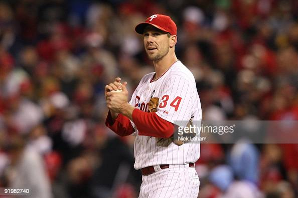 Cliff Lee of the Philadelphia Phillies rubs the ball down against the Los Angeles Dodgers during Game Three of the NLCS during the 2009 MLB Playoffs...