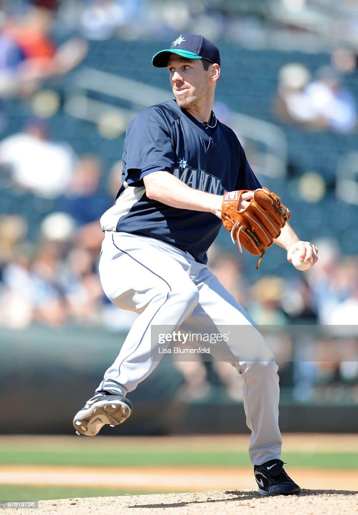 Cliff Lee of the Seattle Mariners pitches during a spring training game against the Texas Rangers on March 10 2010 at Surprise Stadium in Surprise...