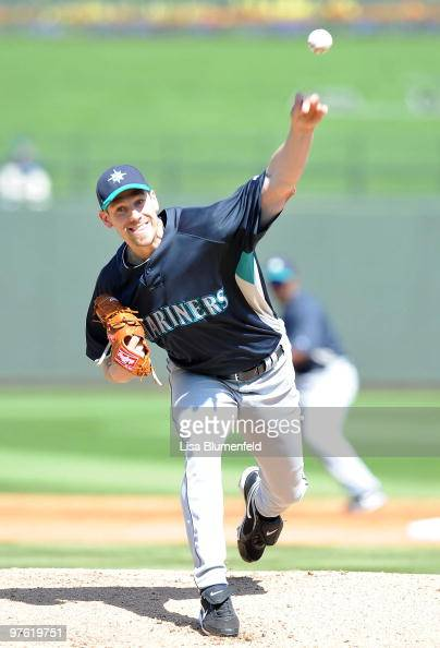 Cliff Lee of the Seattle Mariners pitches during a spring training game against of the Texas Rangers on March 10 2010 at Surprise Stadium in Surprise...