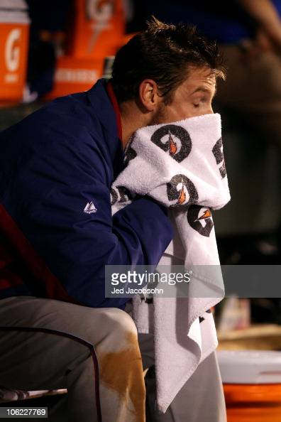 Cliff Lee of the Texas Rangers wipes his face after coming out of the game against the San Francisco Giants in Game One of the 2010 MLB World Series...