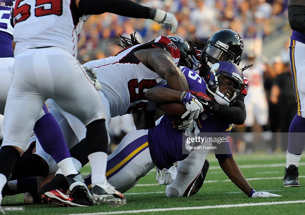 Cliff Matthews and Kemal Ishmael of the Atlanta Falcons tackle Teddy Bridgewater of the Minnesota Vikings during the fourth quarter of the game on...