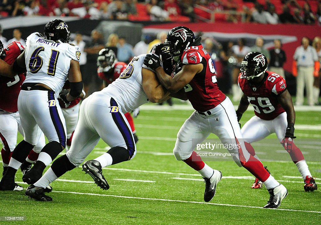 Cliff Matthews of the Atlanta Falcons rushes against the Baltimore Ravens during a preseason game at the Georgia Dome on September 1 2011 in Atlanta...