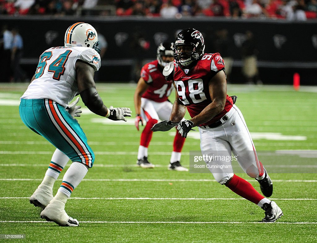 Cliff Matthews of the Atlanta Falcons rushes the passer against Ray Willis of the Miami Dolphins during a preseason game at the Georgia Dome on...