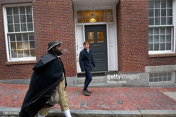 Cliff Odle OF Pawtucket RI who plays 'Barzillai Lew' a cooper musician and colonial militiaman gives a tour of Beacon Hill to Hamish Hawk of...