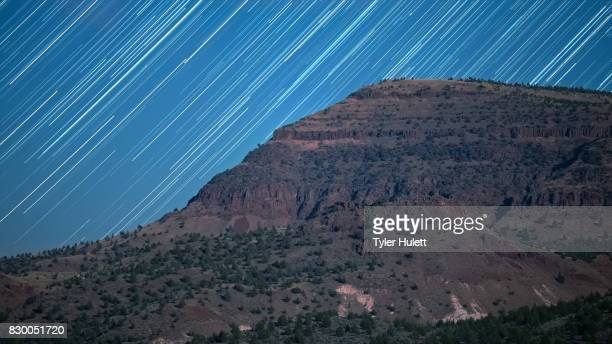 Cliff on Sutton Mountain Night Sky Star Trails Over Oregon