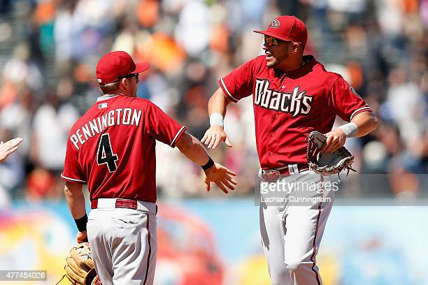 Cliff Pennington and David Peralta of the Arizona Diamondbacks celebrate a win over the San Francisco Giants at ATT Park on June 14 2015 in San...