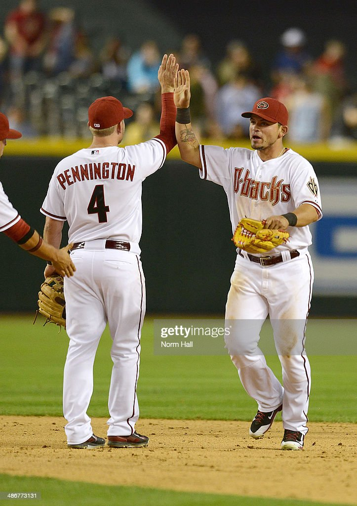 Cliff Pennington #4 and <a gi-track='captionPersonalityLinkClicked' href=/galleries/search?phrase=Gerardo+Parra&family=editorial&specificpeople=4959447 ng-click='$event.stopPropagation()'>Gerardo Parra</a> #8 of the Arizona Diamondbacks celebrate a 5-4 win against the Philadelphia Phillies at Chase Field on April 25, 2014 in Phoenix, Arizona.