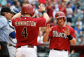 Cliff Pennington and Jordan Pacheco of the Arizona Diamondbacks celebrate after scoring against the Los Angeles Dodgers during the MLB game at Chase...