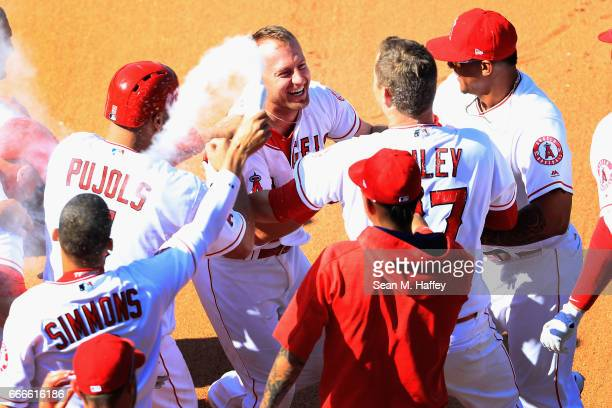 Cliff Pennington is congratulated by Andrelton Simmons Andrew Bailey Albert Pujols Carlos Perez and Martin Maldonado of the Los Angeles Angels of...