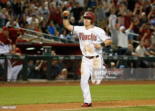 Cliff Pennington of the Arizona Diamondbacks celebrates as he comes in to score the winning run against the Los Angeles Dodgers during the 10th...