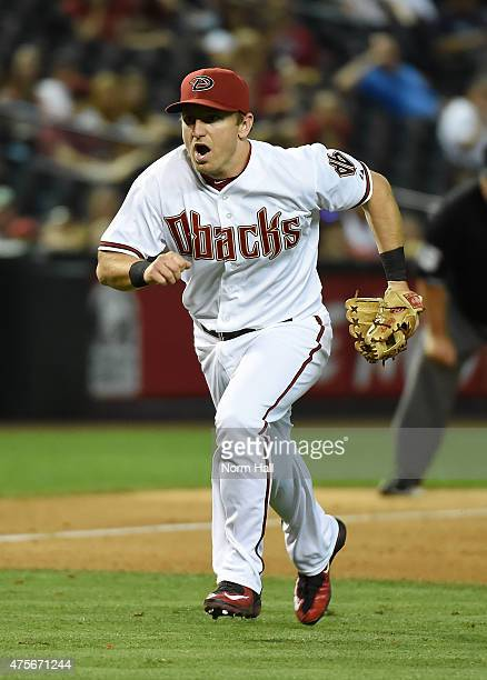 Cliff Pennington of the Arizona Diamondbacks charges in from third base looking for a bunt against the Atlanta Braves at Chase Field on June 2 2015...