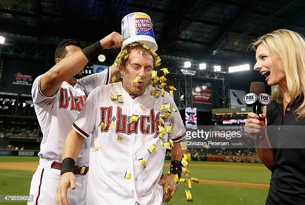 Cliff Pennington of the Arizona Diamondbacks has bubble gum dumped on his head by David Peralta after Pennington hit a walkoff sacrifice fly to...