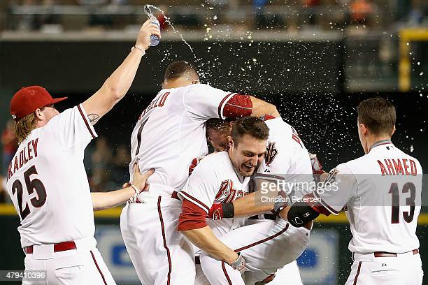 Cliff Pennington of the Arizona Diamondbacks is congratulated by Archie Bradley Welington Castillo AJ Pollock and Nick Ahmed after hitting a walkoff...