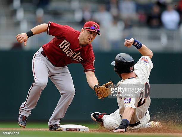 Cliff Pennington of the Arizona Diamondbacks tags out Trevor Plouffe of the Minnesota Twins at second base during the fifth inning of the game on...