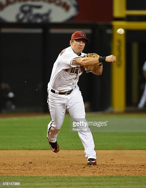 Cliff Pennington of the Arizona Diamondbacks throws the ball to first base against the Atlanta Braves at Chase Field on June 2 2015 in Phoenix Arizona