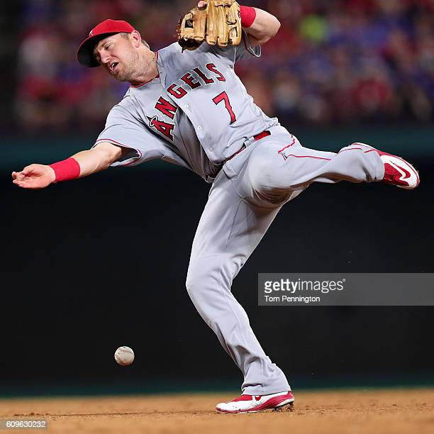 Cliff Pennington of the Los Angeles Angels bobbles a ground ball hit by Carlos Beltran of the Texas Rangers in the bottom of the eighth inning at...
