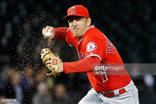Cliff Pennington of the Los Angeles Angels of Anaheim fields the ball and throws to first base to force out Todd Frazier of the Chicago White Sox to...