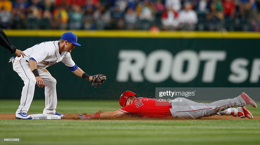 Cliff Pennington of the Los Angeles Angels of Anaheim is tagged out on a steal attempt by shortstop Shawn O'Malley of the Seattle Mariners in the...