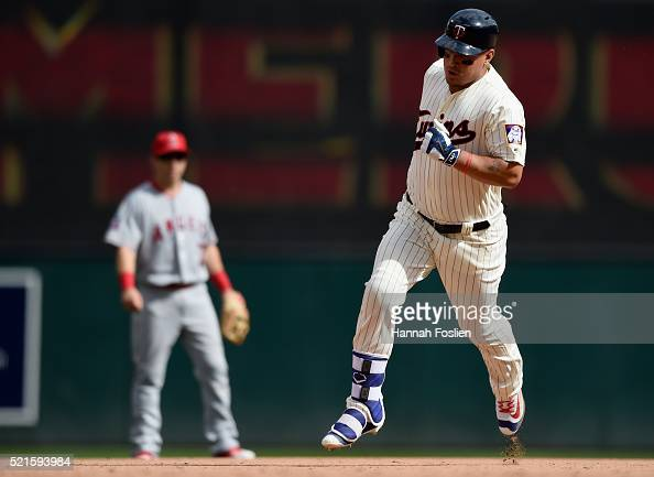 Cliff Pennington of the Los Angeles Angels of Anaheim looks on as Oswaldo Arcia of the Minnesota Twins rounds the bases after hitting a solo home run...