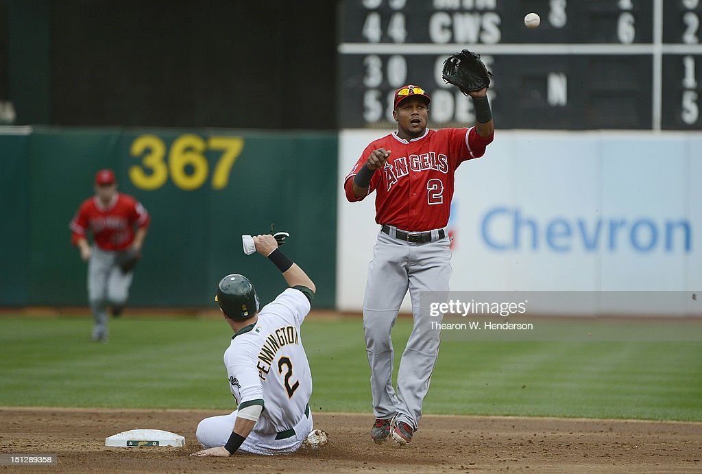 Cliff Pennington #2 of the Oakland Athletics is called safe at second base as <a gi-track='captionPersonalityLinkClicked' href=/galleries/search?phrase=Erick+Aybar&family=editorial&specificpeople=551376 ng-click='$event.stopPropagation()'>Erick Aybar</a> #2 of the Los Angeles Angels of Anaheim was pulled off the bag by the throw in the third inning at O.co Coliseum on September 5, 2012 in Oakland, California.