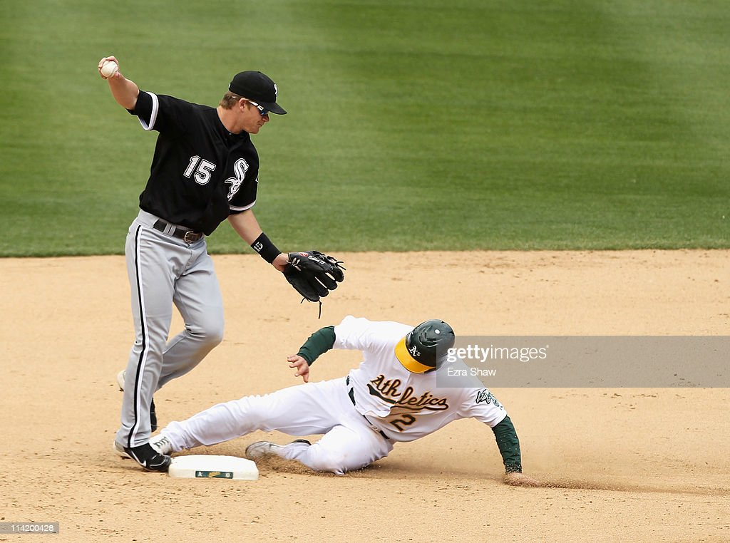 Cliff Pennington #2 of the Oakland Athletics is out at second base but stopped Gordon Beckham #15 of the Chicago White Sox from turning a double play in the seventh inning at Oakland-Alameda County Coliseum on May 15, 2011 in Oakland, California.