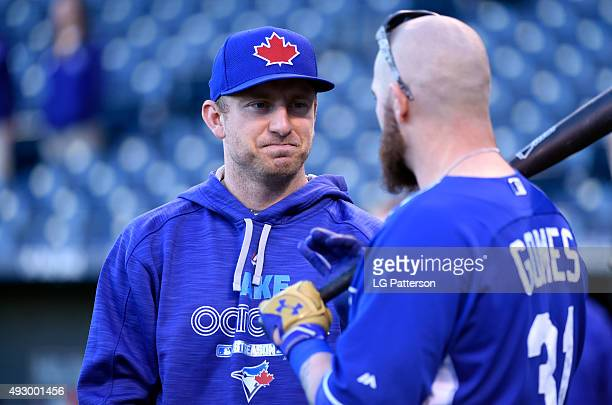 Cliff Pennington of the Toronto Blue Jays and Jonny Gomes of the Kansas City Royals talk on field during batting practice before Game 1 of the ALCS...
