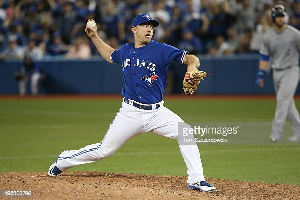 Cliff Pennington of the Toronto Blue Jays delivers a pitch in the ninth inning against the Kansas City Royals during game four of the American League...