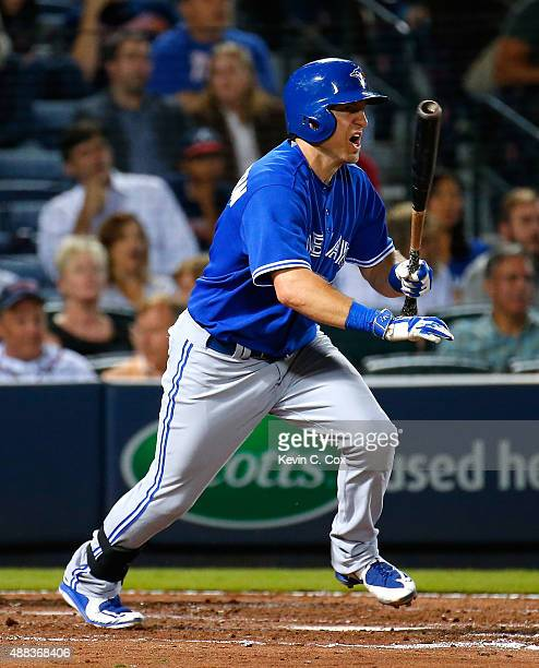 Cliff Pennington of the Toronto Blue Jays hits a single in the fourth inning against the Atlanta Braves at Turner Field on September 15 2015 in...