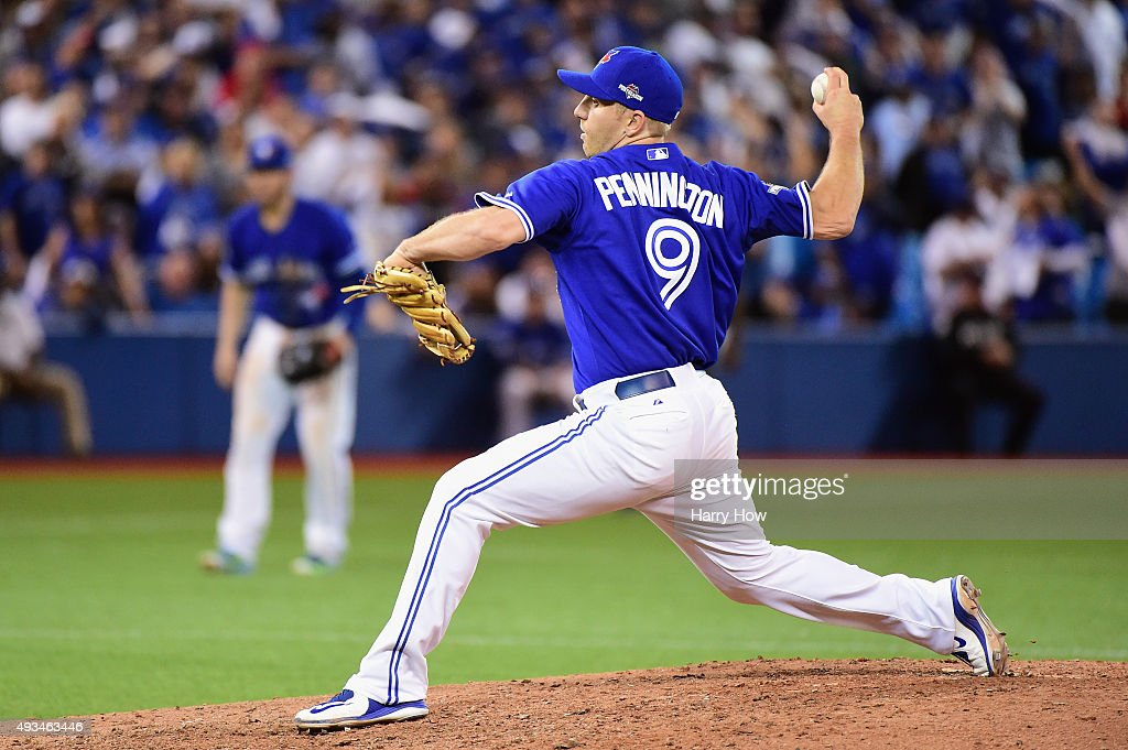 Cliff Pennington of the Toronto Blue Jays throws a pitch in the ninth inning against the Kansas City Royals during game four of the American League...