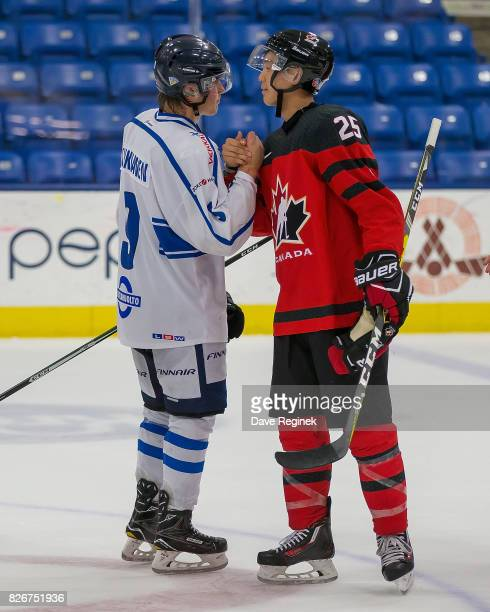 Cliff Pu of Canada shakes hands with Janne Kuokkanen of Finland after a World Jr Summer Showcase game at USA Hockey Arena on August 2 2017 in...