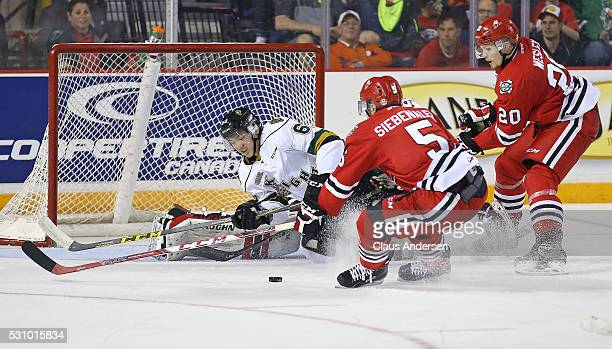 Cliff Pu of the London Knights gets knocked off the puck during a scoring chance against the Niagara IceDogs in Game Four of the OHL Championship...