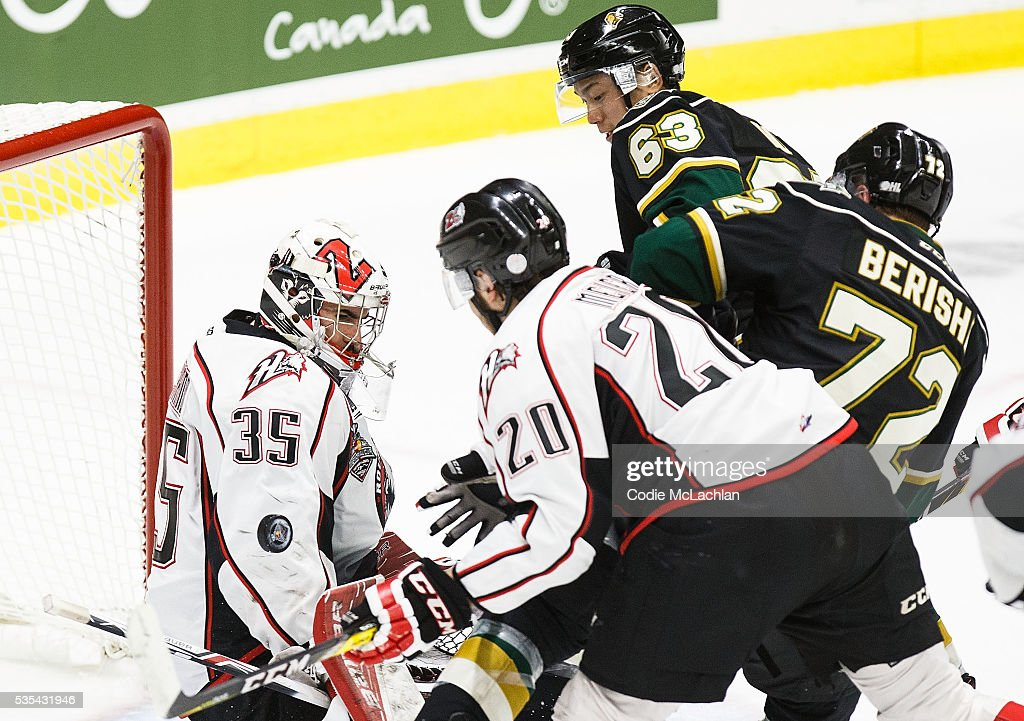 Cliff Pu #63 of the London Knights (OHL) takes a shot on Goaltender Chase Marchand #35 of the Rouyn-Noranda Huskies (QMJHL) during the Memorial Cup Final on May 29, 2016 at the Enmax Centrium in Red Deer, Alberta, Canada.