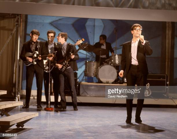 CENTRE Photo of SHADOWS and Cliff RICHARD with the Shadows LR Bruce Welch John Rostill Hank Marvin Brian Bennett Cliff Richard performing on the Show...