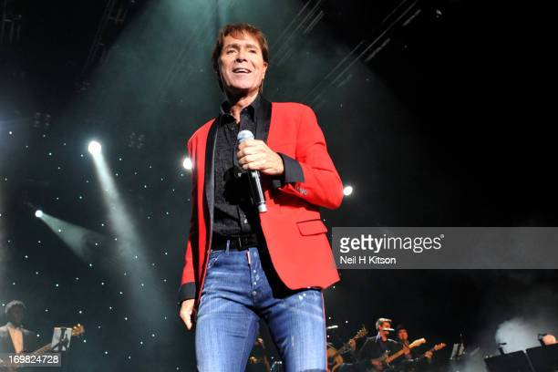 Cliff Richard performs on stage at Manchester Arena on June 2 2013 in Manchester England